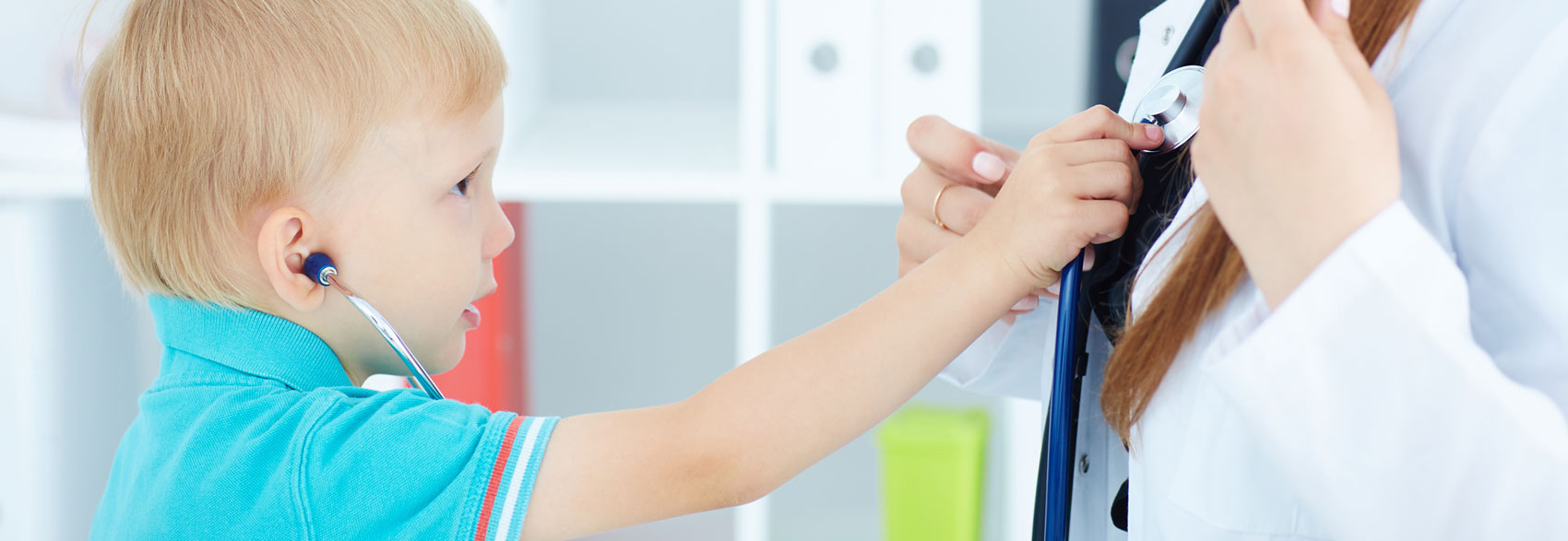 Slide Image child holding stethoscope